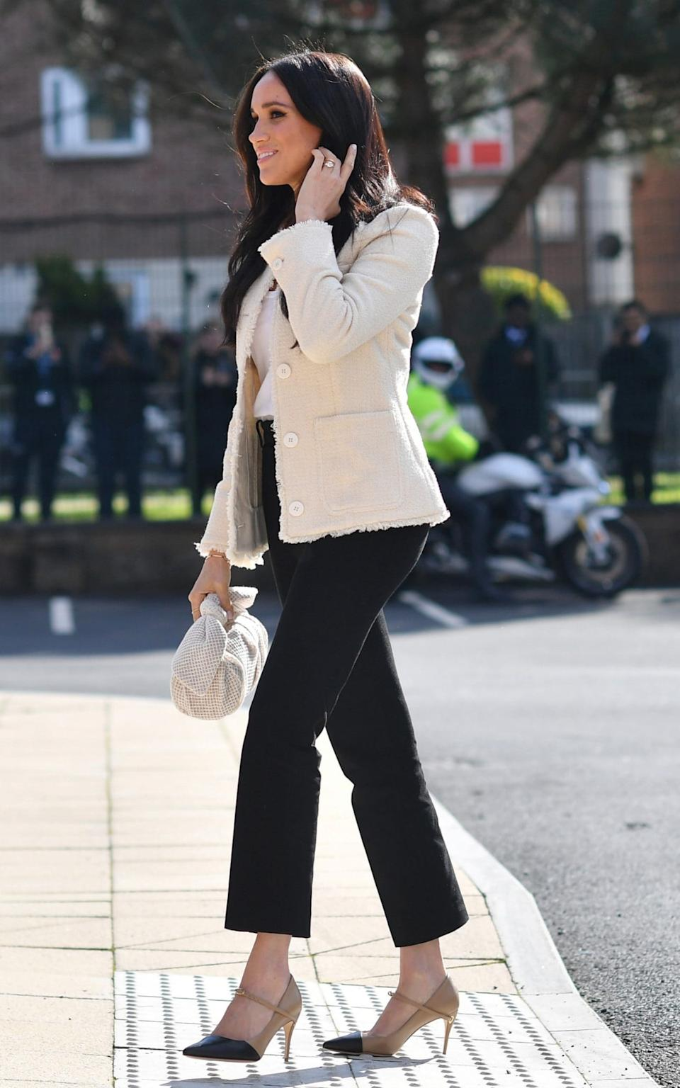Meghan wearing one of her signature pared-back looks in March 2020 - Reuters