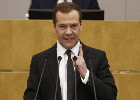 Russian PM Medvedev delivers speech during session at State Duma in Moscow
