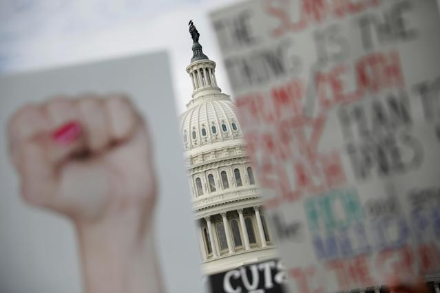 <p>Protest signs are seen during a rally against the Republican tax bill on Capitol Hill in Washington, Nov. 15, 2017. (Photo: Aaron P. Bernstein/Reuters) </p>