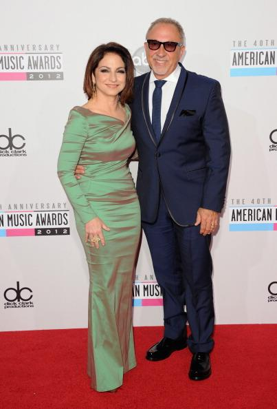 Gloria Estefan and Emilio Estefan arrive on the 2012 American Music Awards red carpet.