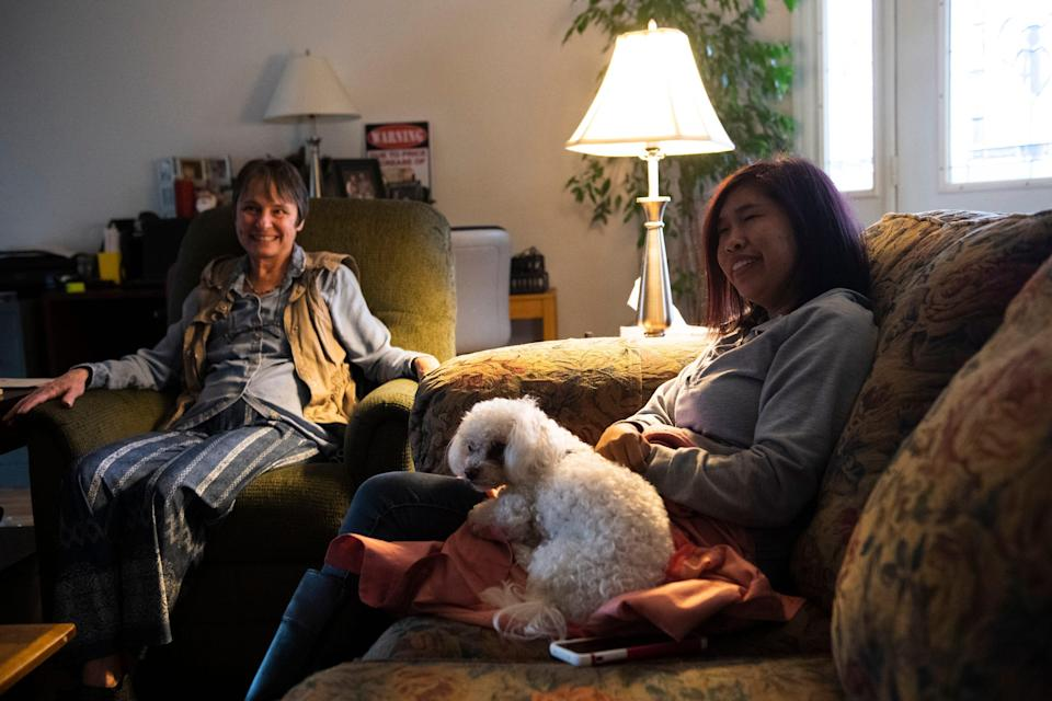 Fatima Quintana sits with Tina Sparks and her dog, Ruffles, in Sparks' home on Monday, March 2, 2020.