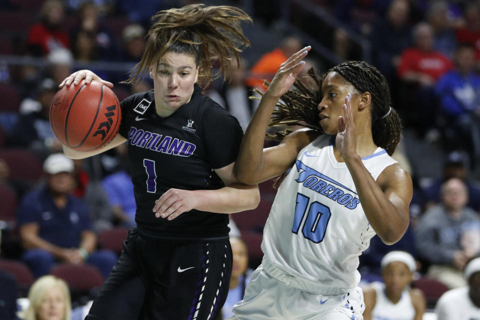 Portland's Kate Andersen (1) drives around San Diego's Myah Pace (10) during the first half of an NCAA college basketball game in the final of the West Coast Conference women's tournament Tuesday, March 10, 2020, in Las Vegas. (AP Photo/John Locher)