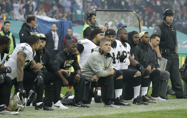 Saints players, including coach Sean Payton, kneel before the team's game on Oct. 1. One New Orleans season ticket holder is suing the team because of the protests. (AP)