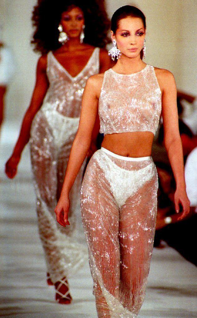 <p>Christy Turlington modeled a crystal crop top, pants, and earrings on the designer's Spring 1993 runway.</p>