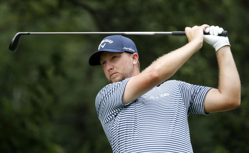 Brice Garnett watches his tee shot on the fourth hole hole during the third round of the Wyndham Championship golf tournament at Sedgefield Country Club in Greensboro, N.C. Saturday, Aug. 3, 2019. (AP Photo/Chris Seward)