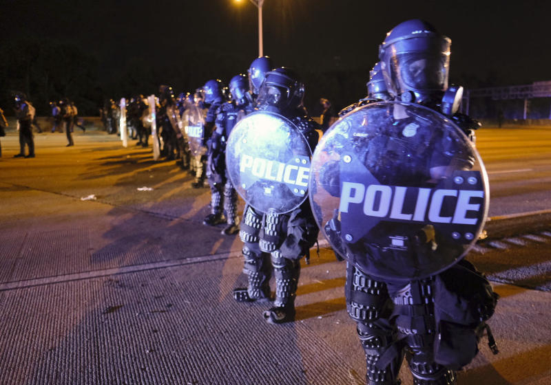After demonstrators got onto I75 and shut down the interstate, police line up in riot gear in Atlanta on Saturday, June 13, 2020. Demonstrators were protesting the death of Rayshard Brooks. Source: AP