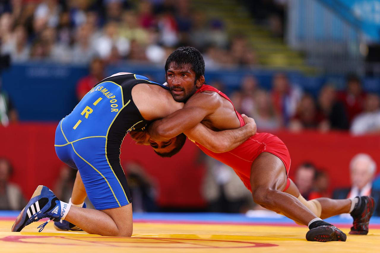 LONDON, ENGLAND - AUGUST 11:  Yogeshwar Dutt of India (red) and Masoud Esmaeilpoorjouybari of Islamic Republic of Iran compete in the Men's Freestyle 60 kg Wrestling on Day 15 of the London 2012 Olympic Games at ExCeL on August 11, 2012 in London, England.  (Photo by Paul Gilham/Getty Images)