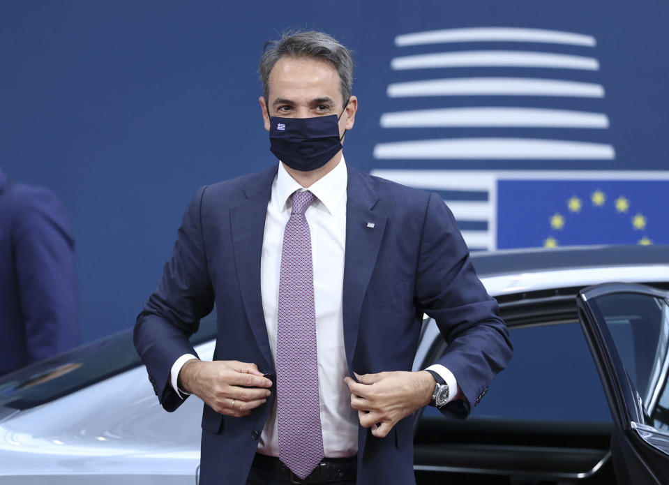 Greek Prime Minister Kyriakos Mitsotakis arrives for an EU summit at the European Council building in Brussels, Friday, June 25, 2021. EU leaders are discussing the economic challenges the bloc faces due to coronavirus restrictions and will review progress on their banking union and capital markets union. (Aris Oikonomou, Pool Photo via AP)