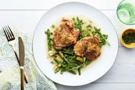 """Gently cooked in olive oil, tender leeks melt like butter over fennel-scented chicken thighs and snappy green vegetables in this easy spring braise. Adjust the vegetables based on your Passover restrictions—some folks avoid peas during this time. <a href=""""https://www.epicurious.com/recipes/food/views/braised-chicken-with-asparagus-peas-and-melted-leeks?mbid=synd_yahoo_rss"""" rel=""""nofollow noopener"""" target=""""_blank"""" data-ylk=""""slk:See recipe."""" class=""""link rapid-noclick-resp"""">See recipe.</a>"""