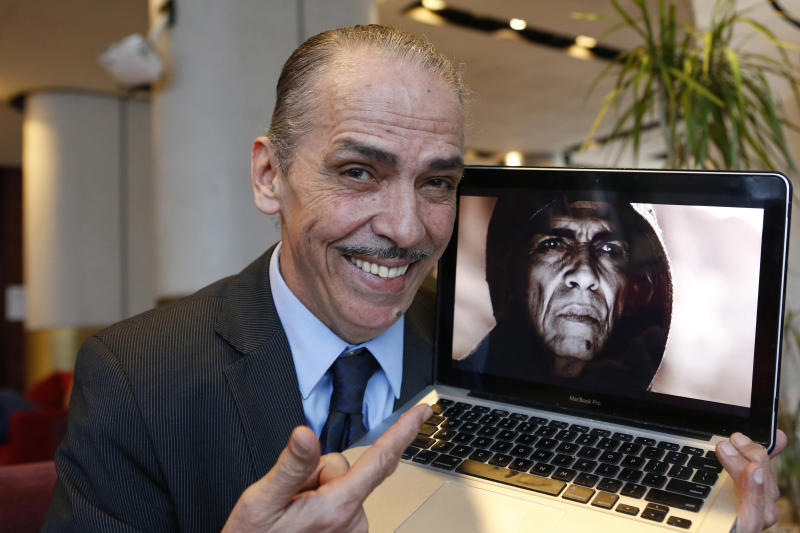 "Moroccan actor Mehdi Ouazzani poses with a frame from his role during an interview with the Associated Press in Casablanca, Morocco Monday, April, 1, 2013. Ouazzani isn't the devil, but he has played one on TV, only he didn't realize that some thought he looked like US President Barack Obama while he was at it. Ouazzani was bemused to wake up one morning and find that his role in The History Channel's popular five-part mini-series ""The Bible"" had become the latest way for conservative commentators in the United States to needle the president. (AP Photo/Abdeljalil Bounhar)"