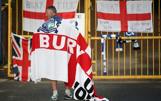 A devastated Bury fan standing outside Gigg Lane - Action Images via Reuters