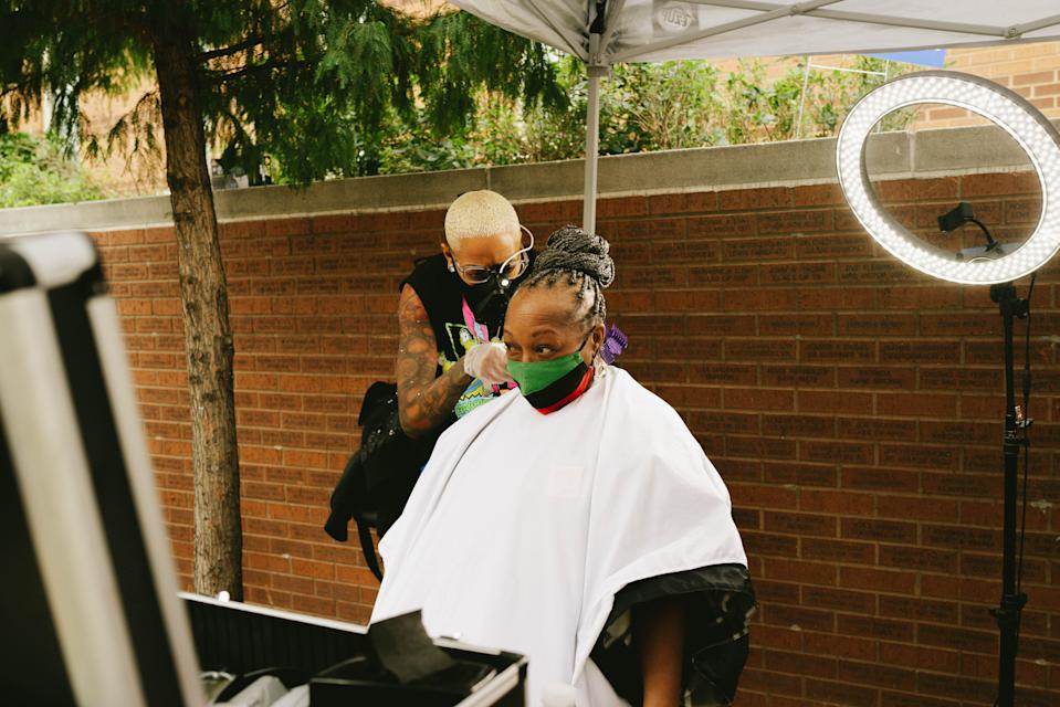 "Jacque' Sci-fi Scott, owner of Another Planet Barbershop in Philadelphia, gave free hair cuts Oct. 18, 2020 as part of an effort to promote voting. ""This is a crucial time. We have to make our voice heard,'' she said."