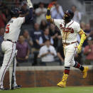 Atlanta Braves' Ronald Acuna Jr., right, celebrates with Freddie Freeman (5) after hitting a home run off Toronto Blue Jays pitcher Robbie Ray in the third inning of a baseball game Tuesday, May 11, 2021, in Atlanta. (AP Photo/Ben Margot)