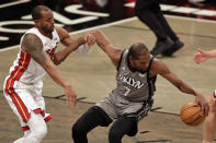 Brooklyn Nets forward Kevin Durant (7) controls the ball while defended by Miami Heat forward Andre Iguodala during the first half of an NBA basketball game Monday, Jan. 25, 2021, in New York. (AP Photo/Adam Hunger)