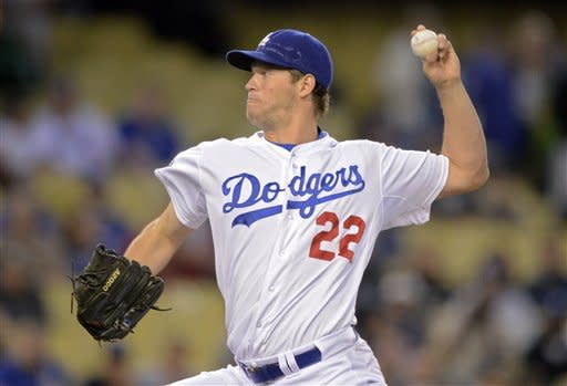 Los Angeles Dodgers starting pitcher Clayton Kershaw throws to the plate during the second inning of their baseball game against the Washington Nationals, Friday, April 27, 2012, in Los Angeles. (AP Photo/Mark J. Terrill)