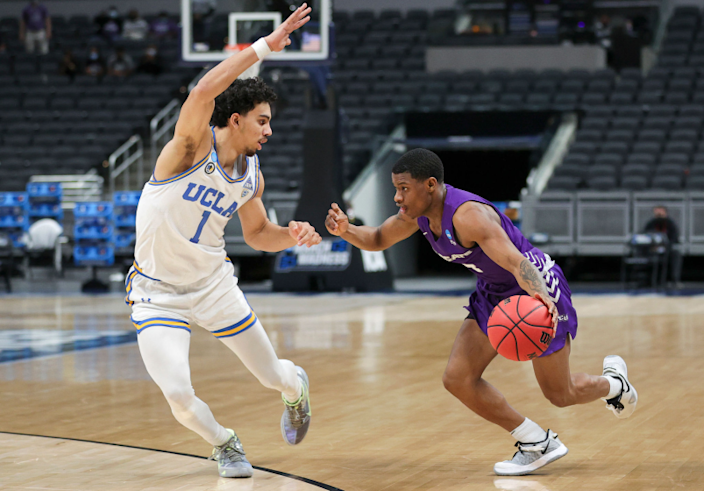 INDIANAPOLIS, INDIANA - MARCH 22: Damien Daniels #4 of the Abilene Christian Wildcats handles the ball.