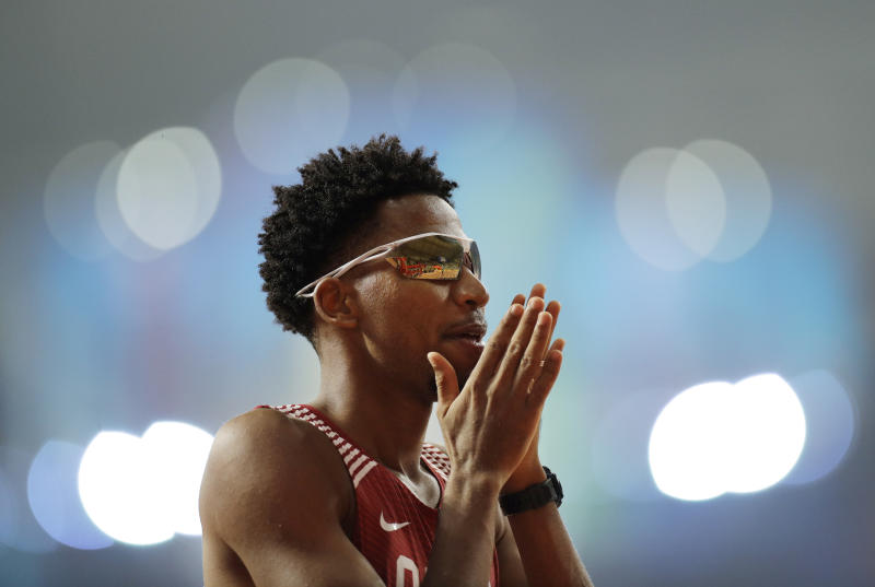 Abderrahman Samba, of Qatar, prepares for a men's 400m hurdles semifinal race at the World Athletics Championships in Doha, Qatar, Saturday, Sept. 28, 2019. (AP Photo/Petr David Josek)