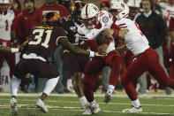 Nebraska quarterback Noah Vedral (16) tries to break free from Minnesota defensive back Kiondre Thomas (31) during an NCAA college football game Saturday, Oct. 12, 2019, in Minneapolis. (AP Photo/Stacy Bengs)