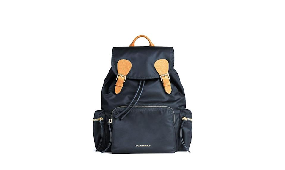 """<p>Burberry Rucksack with personalized monogram, $1,370, <a href=""""https://us.burberry.com/the-rucksack-in-technical-nylonleather-p40148791"""" rel=""""nofollow noopener"""" target=""""_blank"""" data-ylk=""""slk:Burberry"""" class=""""link rapid-noclick-resp"""">Burberry</a></p>"""