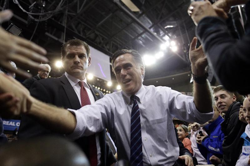 Republican presidential candidate and former Massachusetts Gov. Mitt Romney greets supporters at a New Hampshire campaign rally at Verizon Wireless Arena in Manchester, N.H., Monday, Nov. 5, 2012. (AP Photo/Charles Dharapak)