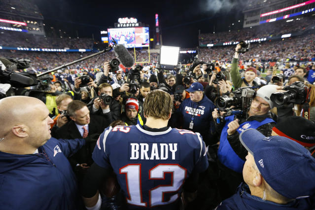 <p>New England Patriots quarterback Tom Brady (12) is followed by media after the AFC Championship Game against the Jacksonville Jaguars at Gillette Stadium. Mandatory Credit: Greg M. Cooper-USA TODAY Sports </p>