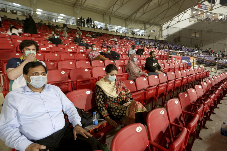Cricket fans watch Pakistan Super League T20 cricket opening match between Karachi Kings and Quetta Gladiators at National Stadium, in Karachi, Pakistan, Saturday, Feb. 20 2021. (AP Photo/Fareed Khan)