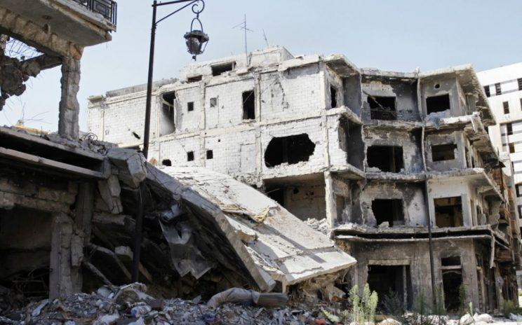 The nearby city of Homs has been devastated by the fighting (Rex)