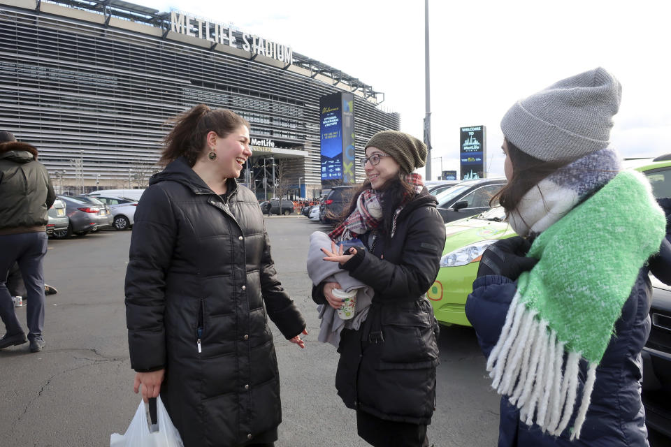 Rachel Leah Freilich and Rivka Lev of New York City talk before entering MetLife Stadium, Wednesday, Jan. 1, 2020, in East Rutherford, N.J., at an event called Siyum HaShas, that celebrates the completion of the reading of the Babylonian Talmud, a process that takes 7 1/2 years The large gathering of Jews drew a significant security presence after recent anti-Semitic attacks in the New York City area. (AP Photo/Ted Shaffrey)