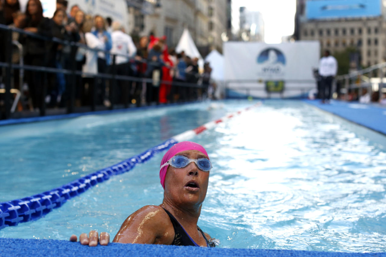 """Long-distance swimmer Diana Nyad, who recently completed a record-breaking swim from Cuba to Florida, completes a lap during a continuous 48-hour marathon swim event in New York's Herald Square called """"Swim for Relief,"""" which aims to raise funds and awareness for Hurricane Sandy recovery efforts, Tuesday, Oct. 8, 2013. (AP Photo/Jason DeCrow)"""