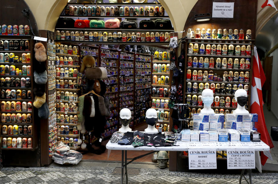 Face masks and gifts are on display at store in Prague, Czech Republic, Thursday, Dec. 3, 2020. A sign of normalcy has returned to the Czech Republic ahead of the Christmas period after the government eased some of its most restrictive measures imposed to contain the recent massive surge of coronavirus infections. On Thursday all stores, shopping malls, restaurants, bars and hotels were allowed to reopen. (AP Photo/Petr David Josek)
