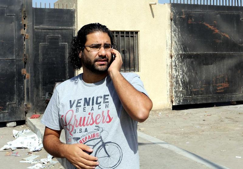 Egyptian activist Alaa Abdel Fattah stands outside the police institute in Cairo on June 11, 2014 (AFP Photo/)