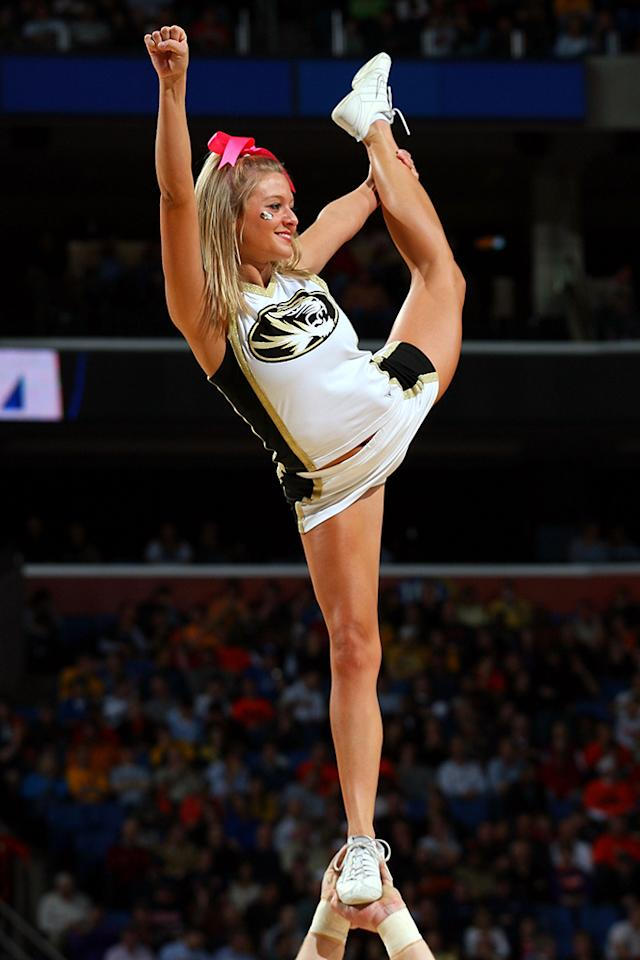 A cheerleader for the Missouri Tigers performs during the first round of the 2010 NCAA men's basketball tournament at HSBC Arena on March 19, 2010 in Buffalo, New York.  (Photo by Michael Heiman/Getty Images)