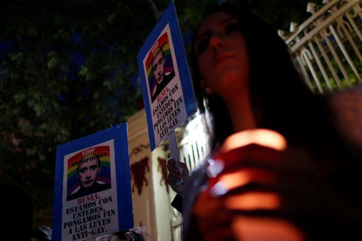 Members of the LGBT community in Mexico protest against the violence against the gay community in Chechnya outside the Russian embassy (AP)