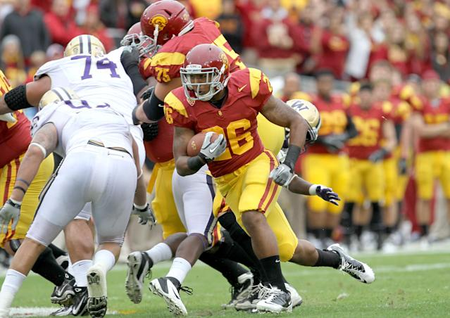 LOS ANGELES, CA - NOVEMBER 12: Running back Marc Tyler #26 of the USC Trojans carries the ball on a 24 yard run down to the one yard line to set up a touchdown in the first quarter agaisnt the Washington Huskies at the Los Angeles Memorial Coliseum on November 12, 2011 in Los Angeles, California. (Photo by Stephen Dunn/Getty Images)