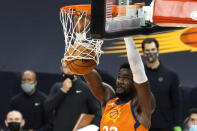 Phoenix Suns center Deandre Ayton dunks against the Denver Nuggets during the second half of an NBA basketball game Friday, Jan. 22, 2021, in Phoenix. (AP Photo/Rick Scuteri)
