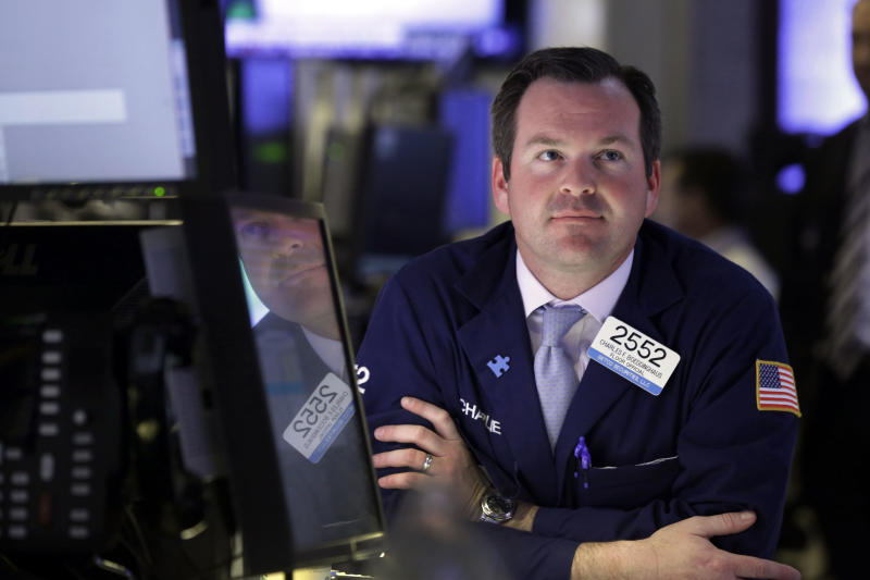 FILE - In this Tuesday, May 7, 2013, photo, specialist Charles Boeddinghaus works at his post on the floor of the New York Stock Exchange. Evidence of a steady economic recovery in the U.S. helped push world stock markets higher Monday.  (AP Photo/Richard Drew)