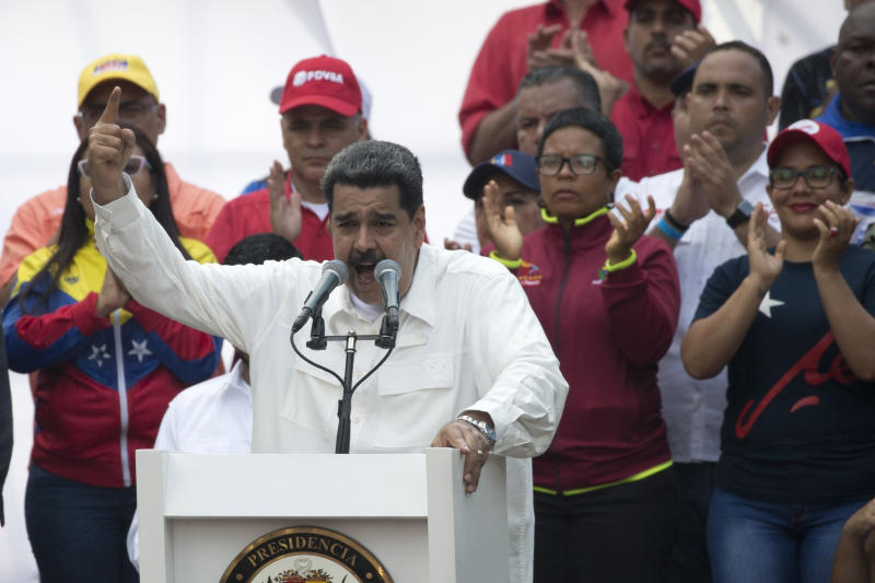 "Venezuela's President Nicolas Maduro speaks to supporters during a government rally in Caracas, Venezuela, Saturday, March 9, 2019. Demonstrators danced and waved flags on what organizers labeled a ""day of anti-imperialism"" in a show of defiance toward the United States, which has imposed oil sanctions on Venezuela in an attempt to oust the president. (AP Photo/Ariana Cubillos)"