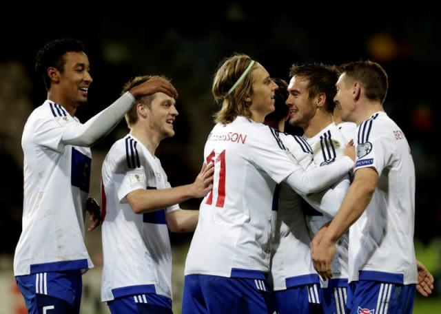 FILE PHOTO: Faroe Islands players celebrate a goal against Latvia in a 2018 World Cup qualifying match