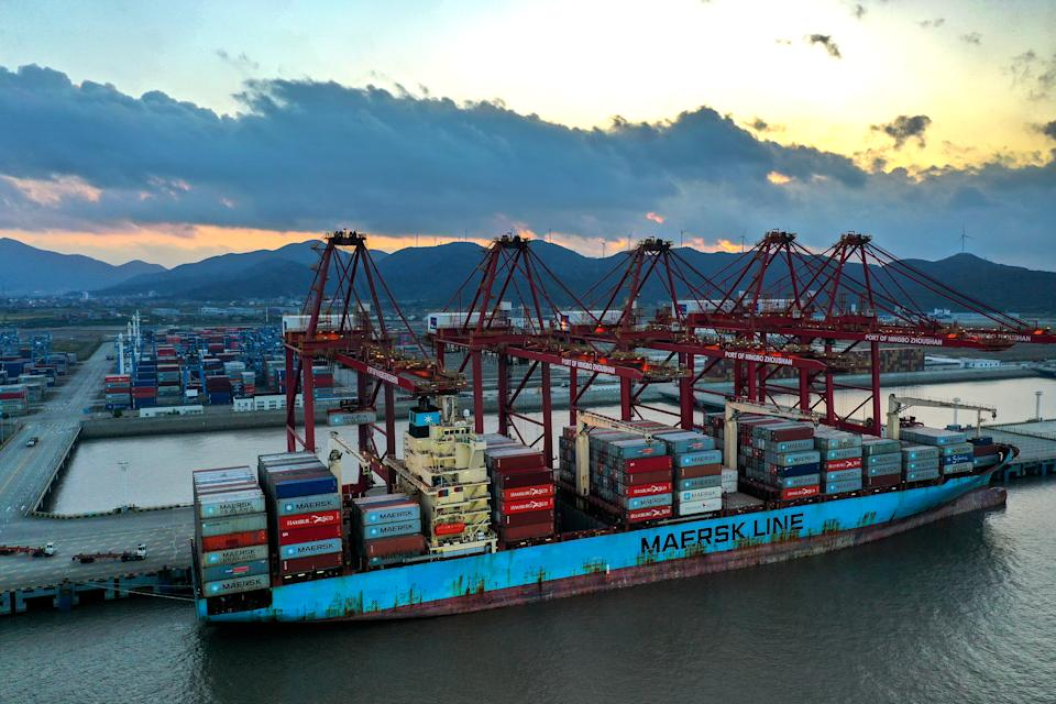 ZHOUSHAN, CHINA - OCTOBER 04: Containers are unloaded from a cargo ship of Maersk Line at Zhoushan port on October 4, 2021 in Zhoushan, Zhejiang Province of China. (Photo by Yao Feng/VCG via Getty Images)