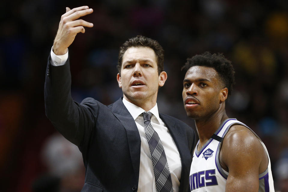 MIAMI, FLORIDA - JANUARY 20:  Head coach Luke Walton of the Sacramento Kings reacts with Buddy Hield #24 against the Miami Heat during the second half at American Airlines Arena on January 20, 2020 in Miami, Florida. NOTE TO USER: User expressly acknowledges and agrees that, by downloading and/or using this photograph, user is consenting to the terms and conditions of the Getty Images License Agreement.  (Photo by Michael Reaves/Getty Images)
