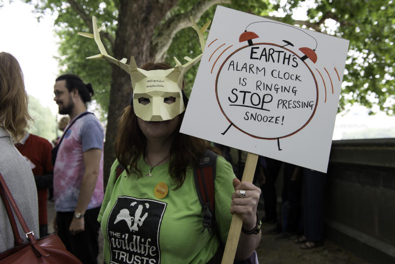 An Environmental protester wearing a deer mask holds a placard that says Earth's alarm clock is ringing, stop pressing snooze during the demonstration. Environmental protesters gathered around Westminster to lobby politicians and tell them that actions need to be done for climate and environment. They also demanded the MP�s to pass new laws to reduce emissions and tackle plastic pollution. (Photo by Andres Pantoja / SOPA Images/Sipa USA)
