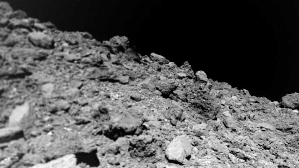 """<p>Ryugu, a common C-type asteroid, is the focus of the Japan Aerospace Exploration (JAXA) mission called <a href=""""http://www.hayabusa2.jaxa.jp/en/"""" rel=""""nofollow noopener"""" target=""""_blank"""" data-ylk=""""slk:Hayabusa2"""" class=""""link rapid-noclick-resp"""">Hayabusa2</a>. Last year, the spacecraft fired a projectile into the asteroid's surface and <a href=""""https://www.youtube.com/watch?v=_vX6SpYhXqk"""" rel=""""nofollow noopener"""" target=""""_blank"""" data-ylk=""""slk:captured some of the resulting debris"""" class=""""link rapid-noclick-resp"""">captured some of the resulting debris</a>.</p><p>Now, it's humming along its journey back to Earth, filled with a treasure trove of cosmic secrets. Later this year, Hayabusa2 will swing past Earth and slingshot a tiny, sample-filled capsule to the ground. There's no doubt that Ryugu will be studied by scientists for years to come.</p>"""