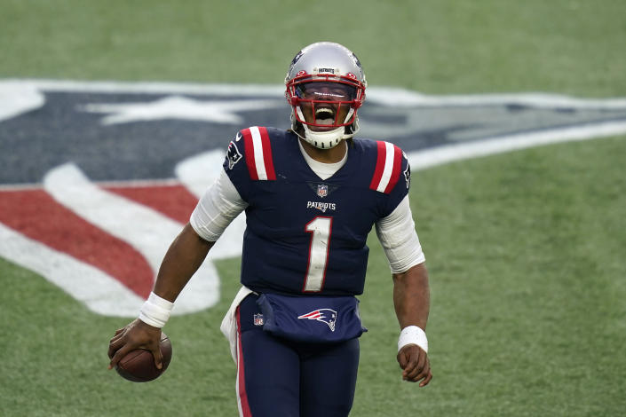 New England Patriots quarterback Cam Newton celebrates his touchdown pass to Devin Asiasi in the second half of an NFL football game against the New York Jets, Sunday, Jan. 3, 2021, in Foxborough, Mass. (AP Photo/Elise Amendola)