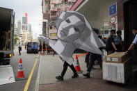 Police officers take away a cardboard featuring the image of Goddess of Democracy from the June 4th Museum as an evidences, in Hong Kong on Sept. 9, 2021. The group, Hong Kong Alliance in Support of Patriotic Democratic Movements of China, that had organized annual vigils in remembrance of victims of the Chinese military's crushing of the 1989 Tiananmen Square pro-democracy protests voted to disband Saturday, Sept. 25, 2021 amid an ongoing crackdown on independent political activism in the semi-autonomous Chinese city. (AP Photo/Kin Cheung)