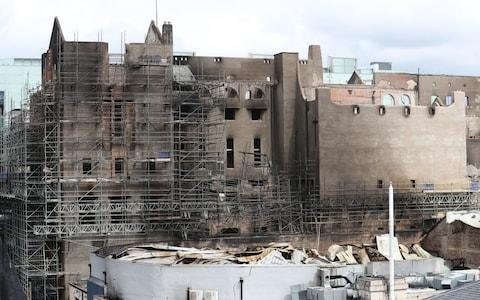 Exterior view of the fire damage at the Glasgow School of Art (GSA) in the historic Mackintosh Building - Credit: PA