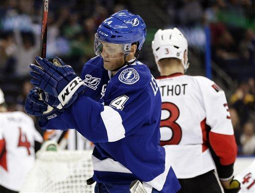 Tampa Bay Lightning center Vincent Lecavalier (4) celebrates after scoring against the Ottawa Senators during the second period of an NHL hockey game, Tuesday, April 9, 2013, in Tampa, Fla. (AP Photo/Chris O'Meara)