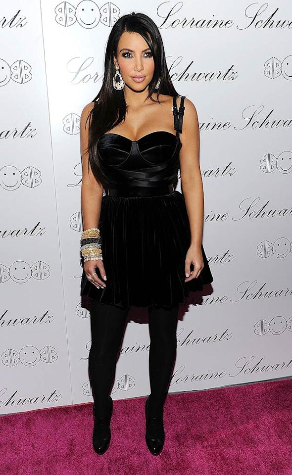 "Reality starlet Kim Kardashian rocked the red carpet sans her rumored new beau Gabriel Aubrey, going solo in a black bustier mini with matching tights and heels. Dimitrios Kambouris/<a href=""http://www.wireimage.com"" target=""new"">WireImage.com</a> - November 22, 2010"