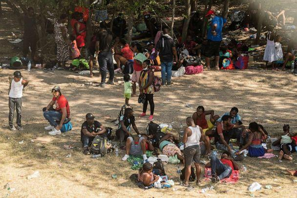 Asylum-seeking migrants rest under shade near the International Bridge between Mexico and the U.S. where asylum-seeking migrants are waiting to be processed in Del Rio, Texas on Sept. 15, 2021. (Go Nakamura/Reuters)
