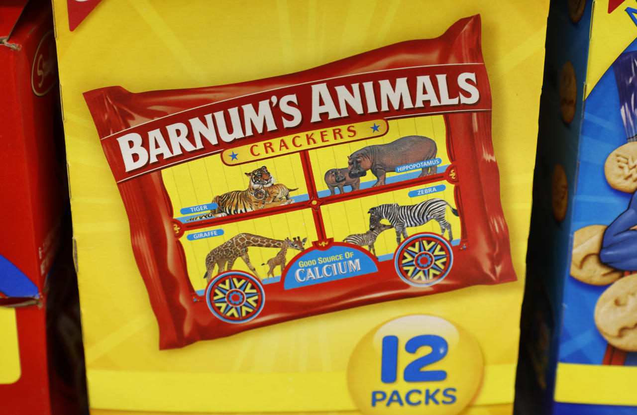 "This Monday, Aug. 20, 2018, photo shows a multi-pack box of Nabisco Barnum's Animals crackers on the shelf of a local grocery store in Des Moines, Iowa. After more than a century behind bars, the beasts on boxes of animal crackers are roaming free. The new boxes retain their familiar red and yellow coloring and prominent ""Barnum's Animals"" lettering. But instead of showing the animals in cages, implying that they're traveling in boxcars for the circus, the new boxes feature a zebra, elephant, lion, giraffe and gorilla wandering side-by-side in a grassland. (AP Photo/Charlie Neibergall)"