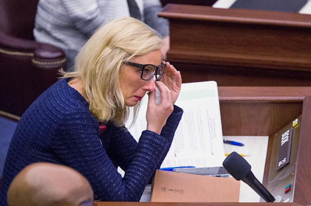 <p>Florida Sen. Lauren Book wipes her eyes after a memorial slide show of the students and teachers that were killed at from Marjory Stoneman Douglas High School during the Senate session the Florida Capitol in Tallahassee, Fla., Feb 21, 2018. The students from Marjory Stoneman Douglas High School are in town to lobby the Florida Legislature after a shooting that left over a dozen dead at their school. (Photo: Mark Wallheiser/AP </p>